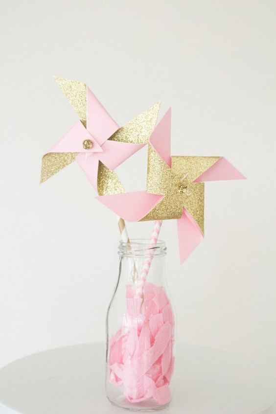 Twelve unique handmade pinwheels with glittery gold centers make the perfect party favor or decorative element. Add them to goody bags or