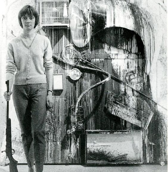 Niki de Saint Phalle in front of finished 'shooting painting', 1961
