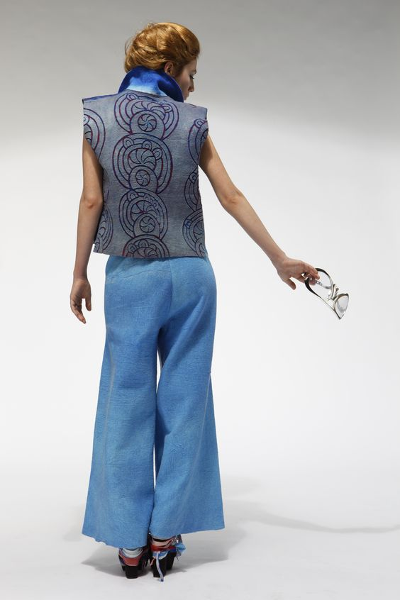 Felted and leather carved waistcoat with sun motifs, nuno felted trousers dittafelt.com