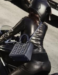 Badass heavy-metal detailing revs up spring's utilitarian bag silhouettes for fashion's easy riders.Vroom vroom.