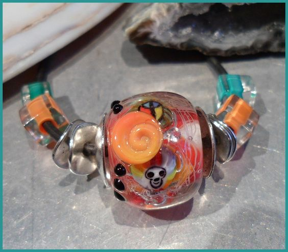 "Close up of ""Peace Out"" Lampwork Necklace."