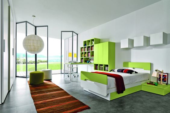 Z015 Link System: eden green suspended bookcase. Monopoli: open pore thermo structured white oak melamine wall units, push handles. Scriba: desk with a white structure and eden green surface [by Gruppo Euromobil].