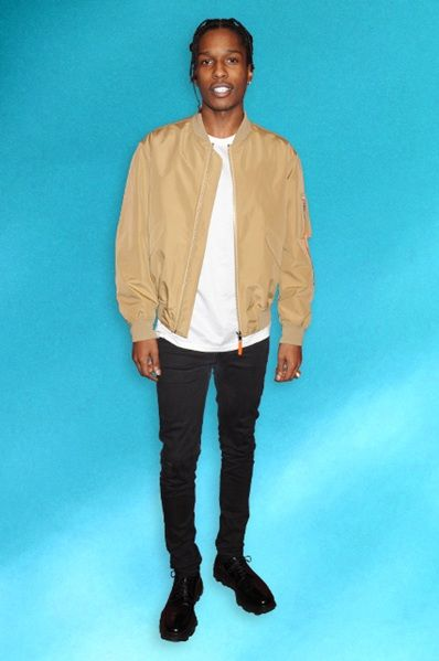 ASAP Rocky in a beige bomber jacket