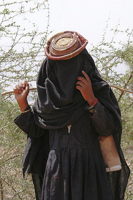Veiled woman with a little hat - Shahara area - Yemen by Eric Lafforgue, via Flickr