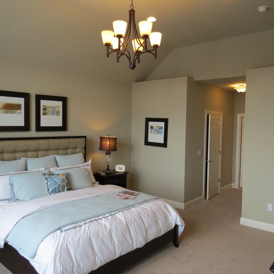 Master Bedroom in our Melrose model, with neutral color scheme and blue accents