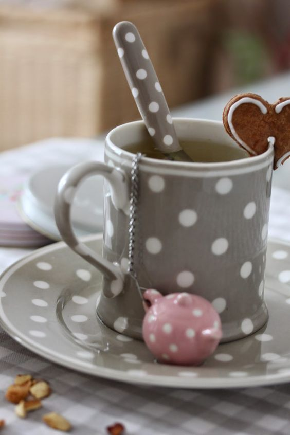 Everything about this makes me happy: the polka dots, the teapot tea infuser the matching spoon and the heart shaped cookie: