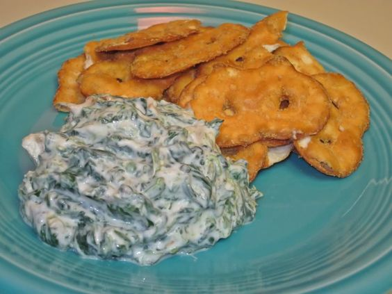 Spinach Dip - only 100 calories for 1/2 cup! YUM!  1 packet of Knorr's dry vegetable soup mix (or any dry vegetable mix)  10 oz. frozen spinach, thawed and squeezed dry  8 oz. water chestnuts, chopped  8 oz. light sour cream  8 oz. lowfat (2%) plain Greek yogurt  8 oz. nonfat plain Greek yogurt