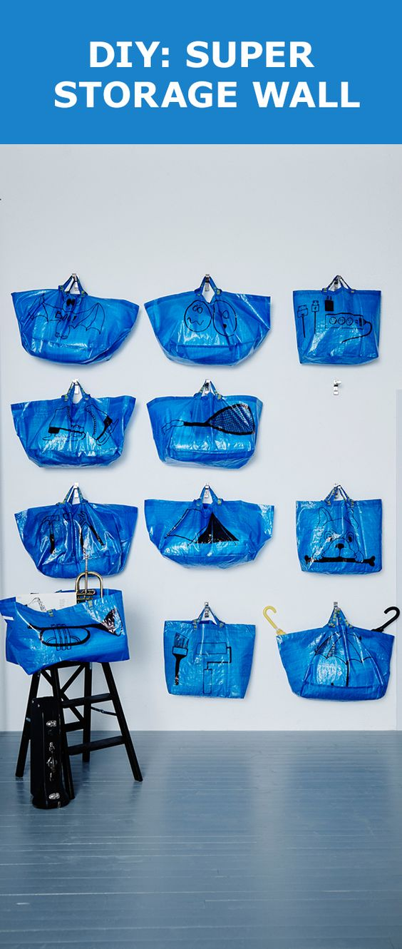 Looking for an inexpensive storage wall? This fun DIY reuses the beloved IKEA FRAKTA bags to create an easy way to keep you organized. Hang them up and draw on them so you always know what's inside!