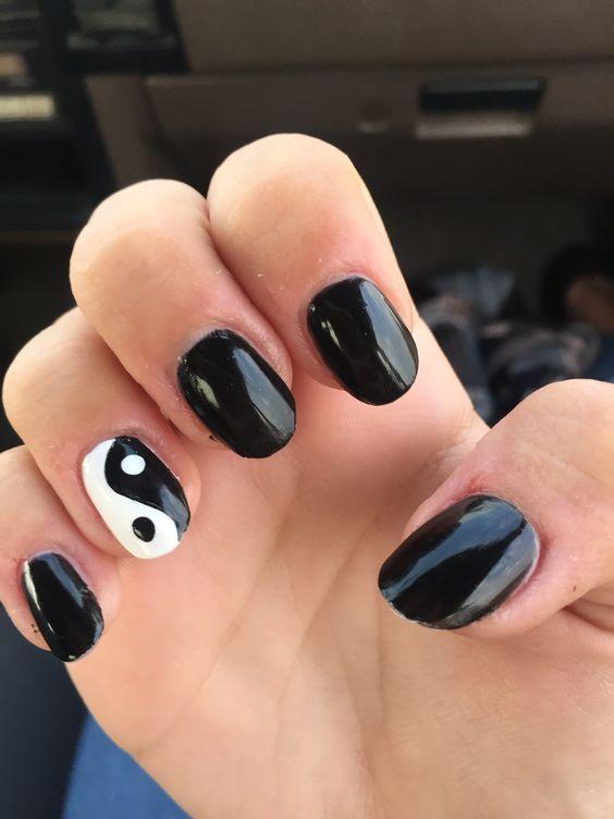 My boyfriends mom did my nails, black ying yang