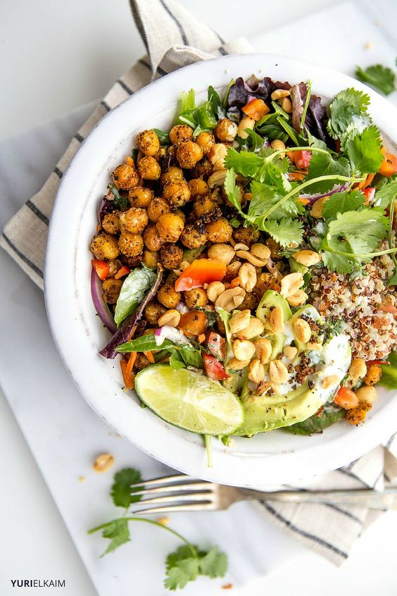 """This hearty quinoa bowl, which makes for a deliciously filling lunch or dinner salad, boasts incredible flavor and a protein-powered chickpea """"crunch""""."""