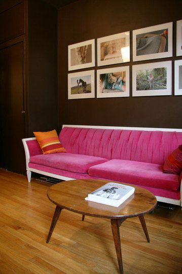 Chocolate brown walls and pink and white sofa