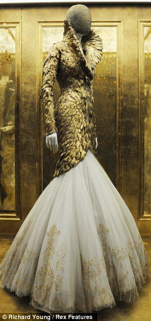 Savage Beauty: McQueen was known for using high contrast in his work, marring dark and light, and soft and hard. It is a skill Mrs Burton has inherited and continued in the label's designs since his death