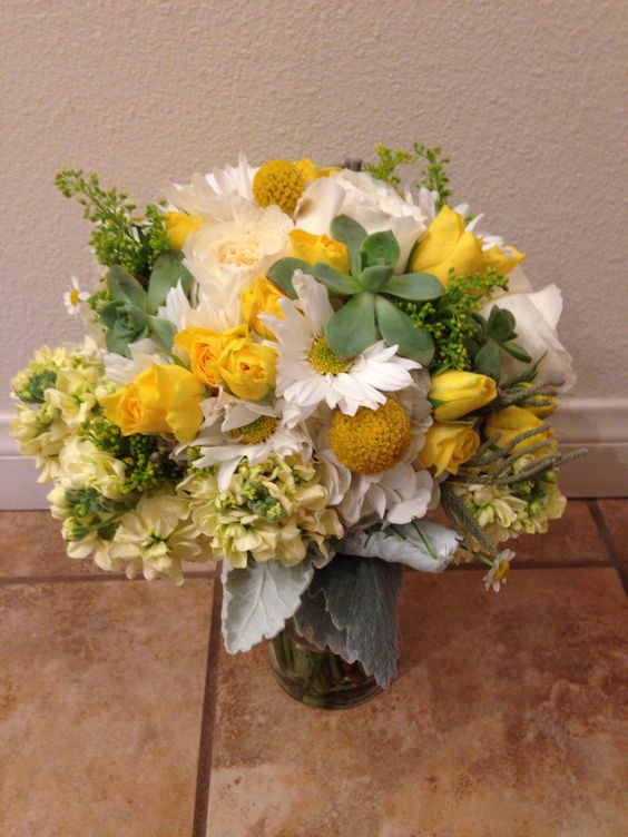 Yellow and ivory bridal bouquet accented with succulents.  Bouquet by The Exotic Green Garden. www.exoticgreengarden.com