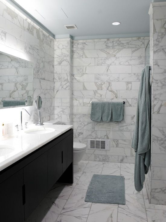 Calcutta gold marble honed on the floors polished on the for Tumbled marble bathroom designs