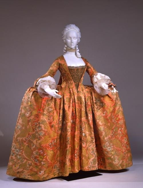 Robe à la Française, 1740s : Women with coquettish airs were wearing robes à la française and robes à l'anglaise throughout the period between 1720 and 1780. The silhouette of the robe à la française, composed of a funnel-shaped bust feeding into wide rectangular skirts, allowed for expansive amounts of textiles with delicate decoration.: