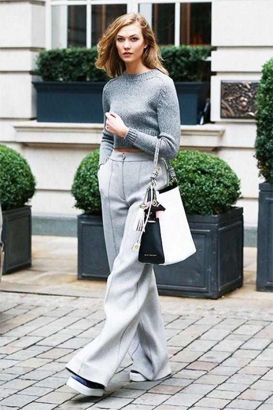 On Kloss: Elisabetta Franchi Sweater; Amanda Wakeley Ito Wool Pants ($490); Kurt Geiger London Flatform Low Top Trainers ($215); Kurt Geiger London Woven Penelope Hobo Bag...