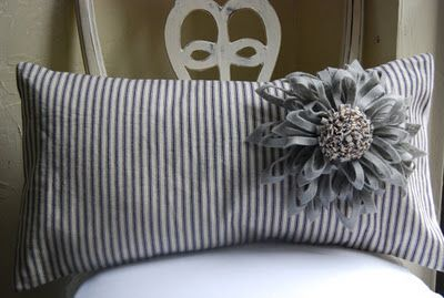 Like this idea...maybe blue ticking fabric with wool flowers.