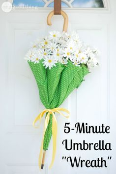 I love a beautiful front door wreath...but if you're looking for something new to add some cheer to your front door, try this simple flower-filled umbrella instead!: