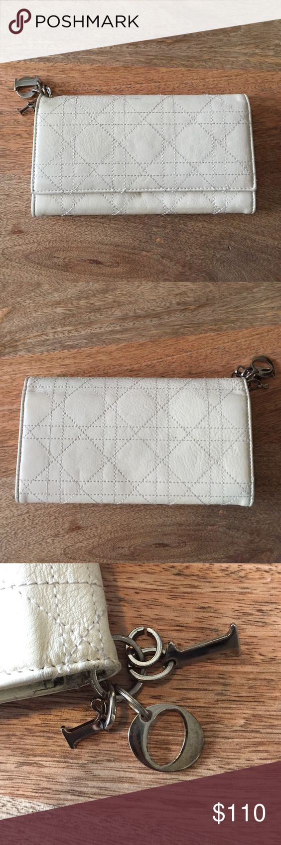 """authentic DIOR cannage quilted charm wallet ✨Preowned Dior wallet bought at Saks back in 2007. %. authentic. 7"""" length 4"""" height. The condition overall is great and has no tears or odor. I took care of the wallet and only used it for a few months. The 1 problem this wallet has is the gunmetal DIOR charms on the corner of wallet is MISSING the """"D"""" because ring got loose. Therefore the charms only have the """"I"""" """"o"""" and """"r"""". Edges show wear. Doesn't come with box or dust bag. Check out my closet…"""