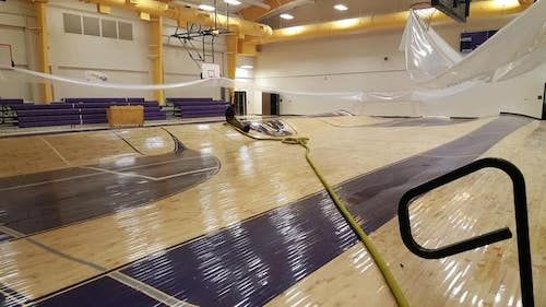 Flooded Middle School Gym Floor Becomes Hulking Waves Of Maple Wood Floor Business Magazine Maple Wood Flooring Gym Flooring Wood Floors