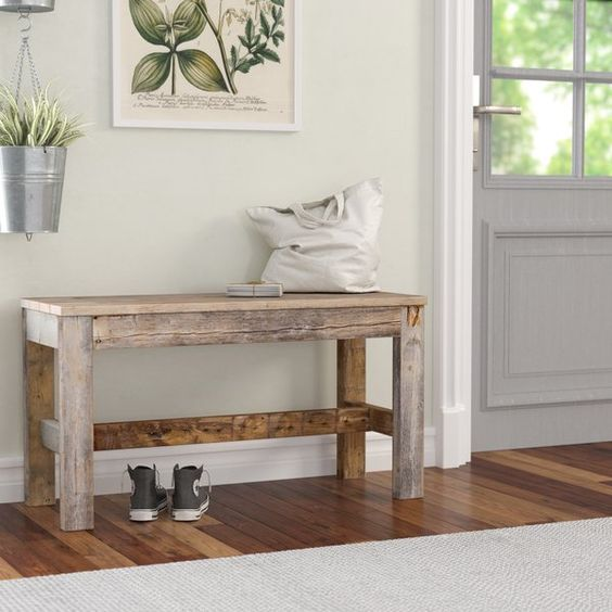 Reel in a rustic touch to any arrangement without breaking the bank or sacrificing too much square footage with this versatile bench. Made in the USA from reclaimed wood, this budget-friendly piece showcases clean lines and a neutral finish for a well-worn look that blends with a variety of color palettes and aesthetics. Its petite 19.5'' H x 36'' W x 14'' D silhouette makes it an ideal option for smaller spaces. No assembly is required.