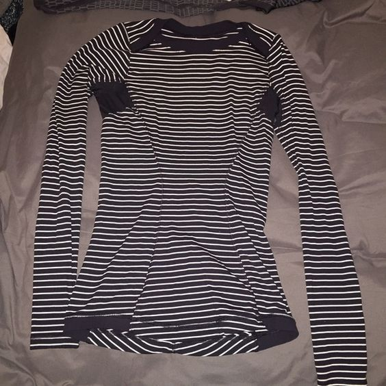 Black & white striped LS EUC. Worn a few times. Amazing fit. Gathered in the back. Thumb holes. Flattering slimming stripes. lululemon athletica Tops Tees - Long Sleeve