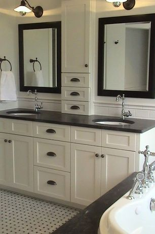Traditional master bathroom with soapstone counters for Height of bathroom mirror