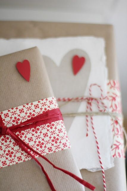 50 Creative Gift Wrapping Ideas for Christmas: could use scrapbooking paper, cut the edges with crafty scissors, wrap around the package already wrapped in brown paper, add ribbon, and done : ):