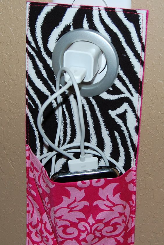 Cell phone Wall socket charging holder...keeps cords out of way!