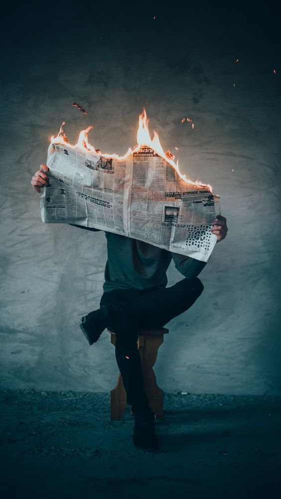 Surrealism Photography Of Person Reading News Paper In Fire While Sitting On Stool Surrealism Photography Newspaper Photo Fire Photography