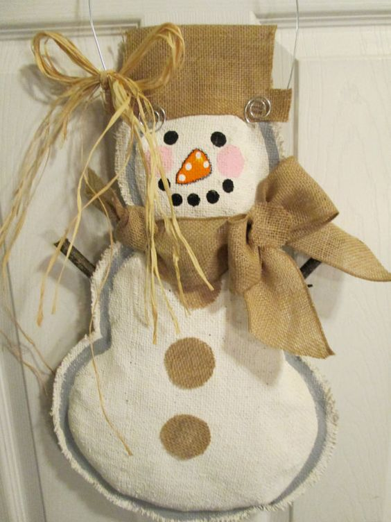 My original design. Hand painted natural burlap full body snowman! White acrylic paint base with acrylic painted features with burlap ribbon scarf