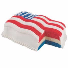 It´s red, white and blue through and through! Cake batter is tinted before baking and the colorful layers sandwich a sheet of luscious ice cream. The coolest summer cake ever.