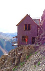 Hike to The Old Hundred Mine boarding house outside of Silverton, Colorado. It's a literal cliff hanger! Blog post all about how to get there and what you need to know.