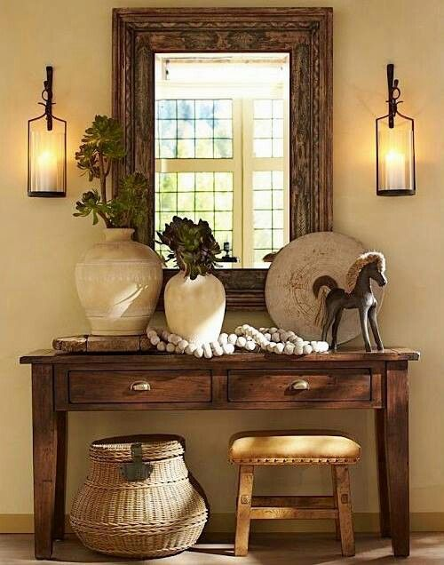 Great table for the foyer. I also like the wood frame for the mirror.:
