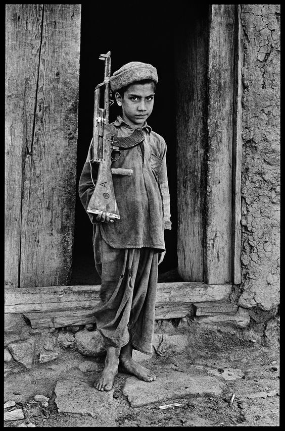 00829_01, Afghanistan, 1980, AFGHN-13342Life in Black & White by Steve McCurry This boy has never held a book in his hands, has never attended school, and has never known a life without the threat of violence.