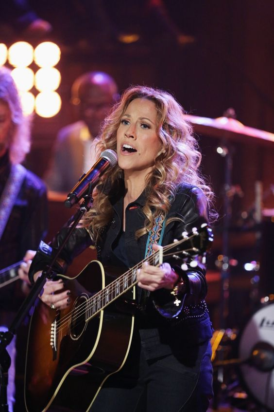 """With one stroke of her guitar, Sheryl Crow makes it look """"Easy"""" during a performance on """"Late Night With Jimmy Fallon"""" on Nov. 14 in New York"""