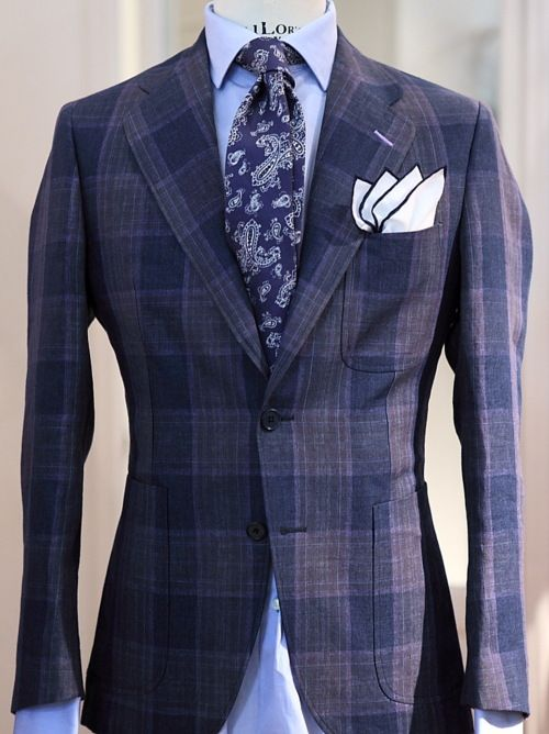 Unlined linen jacket with three patch pockets