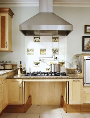A roll under stove is as beautiful as accessible the moveable water faucet fills pots without - Accessible kitchen design ...