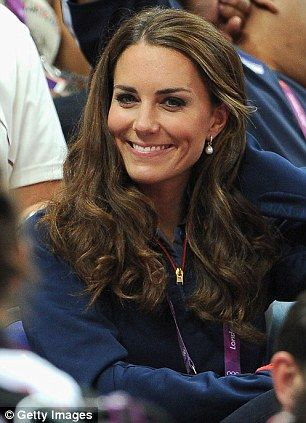 The Duchess smiles for the camera as she cheers on the athletes at the Greenwich Arena:
