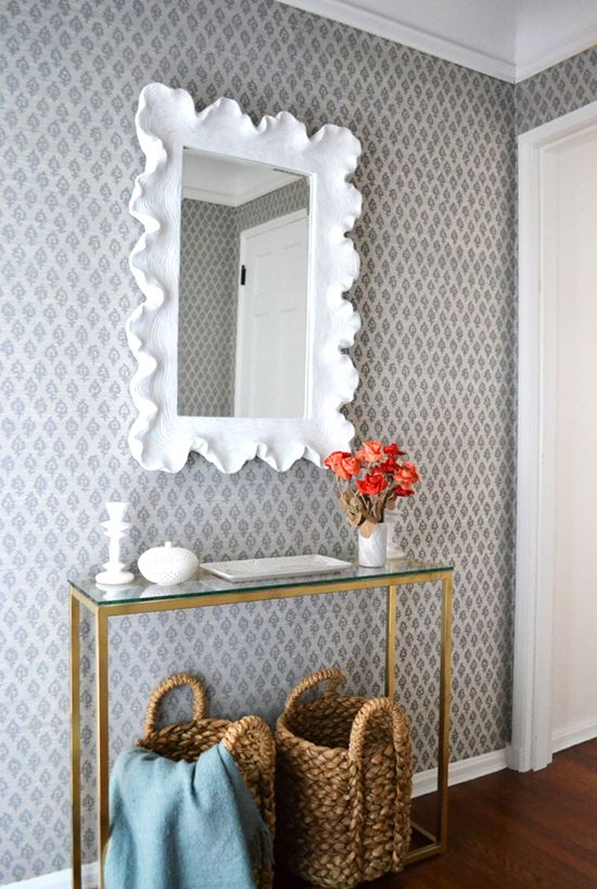 brian paquette entryway, quadrille patterned wallpaper, thin console, ballard mirror, jute basket, foyer styling, console styling