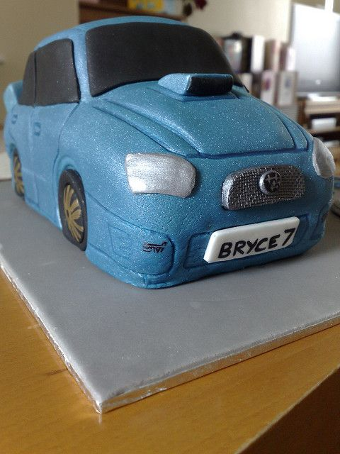 Front/side view of Blue Subaru STi cake for a friends son's birthday     I want toconsume  sweets.  answer is