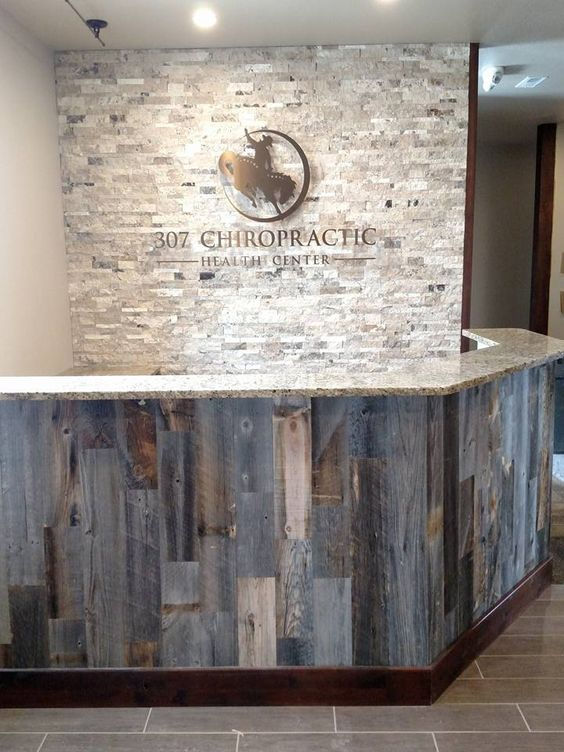 Office front desk using @stikwooddesign reclaimed peel and stick wood.