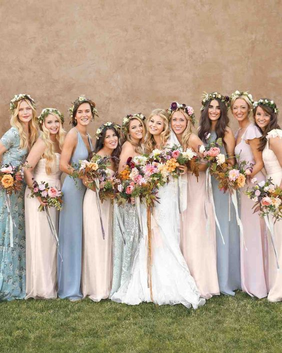 Amanda's bridesmaids wore gowns from Amsale and Reformation in shades of shell pink, white, light blue, and gray.
