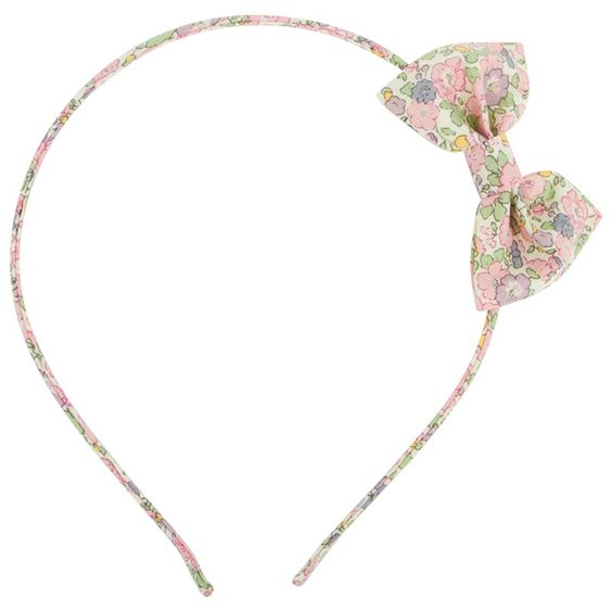 Contrast her winter wardrobe with the cute Betsy-Ann liberty print bow headband from Woodstock.