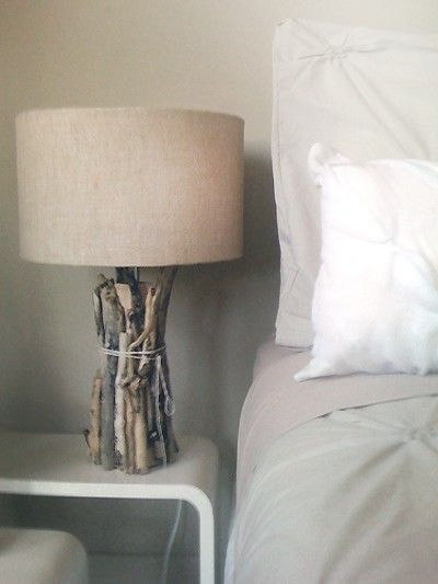 DIY Driftwood Lamp. Secure driftwood around the base of a lamp with some twine. So easy.