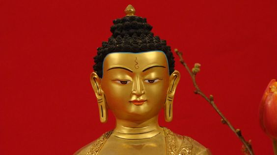 Detailed from a Buddha's face with gold leaved with such beauty and serenity.