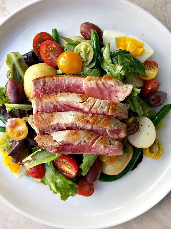 Seared ahi tuna nicoise salad with fingerling potatoes, olives heirloom cherry tomatoes, green beans, and a soft-boiled egg. Light, fresh and very satisfying: