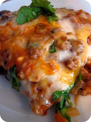 Cheesy Enchilada Casserole!  Actually made this last night, but substituted the ground beef for shredded chicken, it was absolutely divine!!!