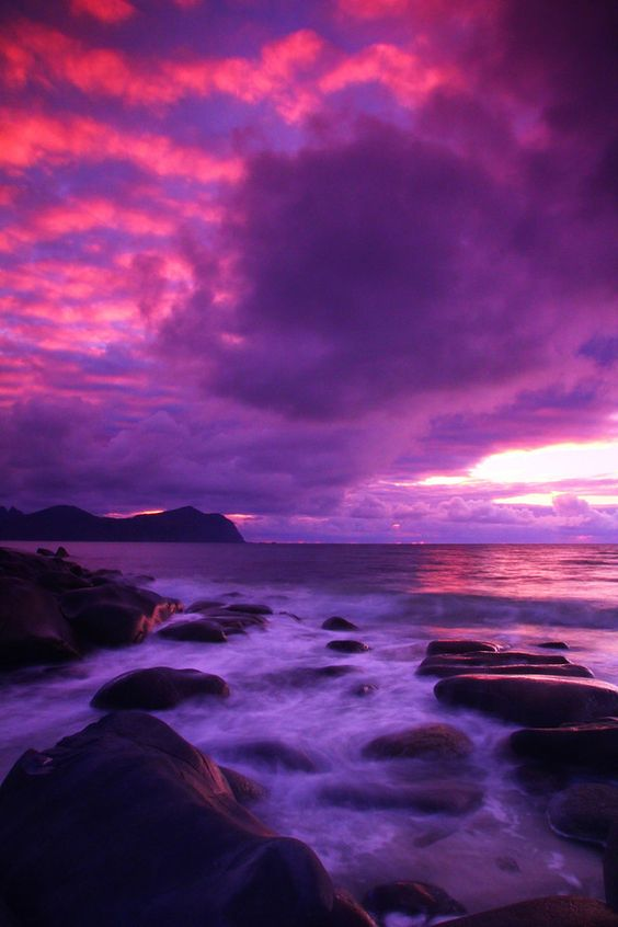 Norway - Claudio.  Beautiful pink and purple sky reflecting off the water.: