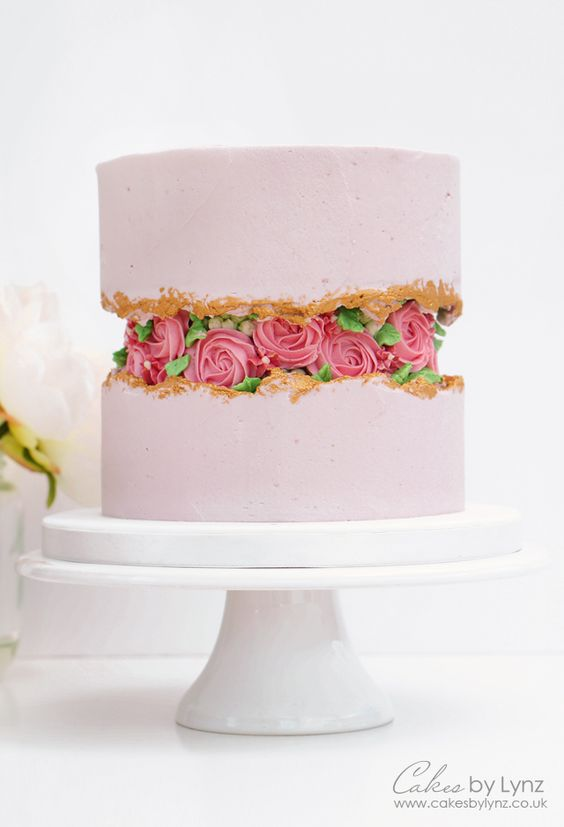 Buttercream Rose Fault Line Cake | 15+ Fault Line Cakes that WOW! Click over to Rose Bakes to see several designs of the trendy Fault Line Cakes that are so popular right now! #faultline #faultlinecakes #cake #faultlinecake #birthday #cakes #birthdaycakes #buttercream #buttercreamroses #pinkcake #pinkandgold #pink